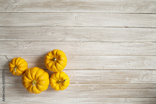 Deurstickers Narcis pumpkins on wooden board