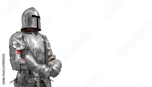 Vászonkép Knight in shiny metal armor on a white background.