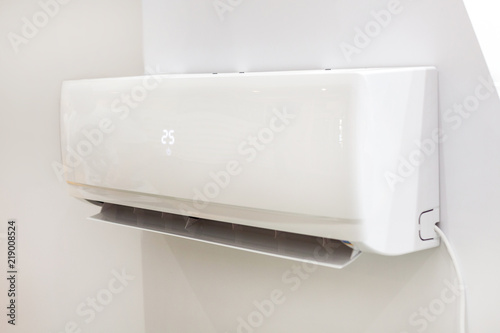 White air conditioner on a wall with temperature display Wallpaper Mural