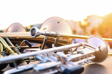wind instruments lying on a table against a blurred background