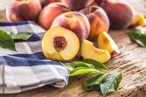 A group a ripe peaches on wooden table