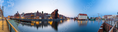 obraz PCV Panorama of Gdansk old town reflected in Motlawa river at dusk, Poland