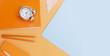 Leinwanddruck Bild - Back to school styled scene with school supplies on blue and orange background banner