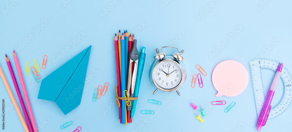 Fototapety, obrazy: Back to school styled scene with school supplies on blue background banner