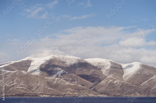 Staande foto Vulkaan Beautiful view of the lake and mountains with snow. Armenia ,Sevan lake