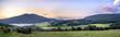 Połonina Caryńska w Bieszczadach o wschodzie słońca. Widok z przełęczy Wyżnej. W oddali Tarnica