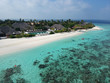 Drone aerial view set of a paradise island resort in maldives.