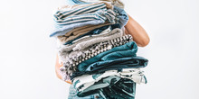 Woman Takes In Hands Big Pile Blue And Beige Laundry