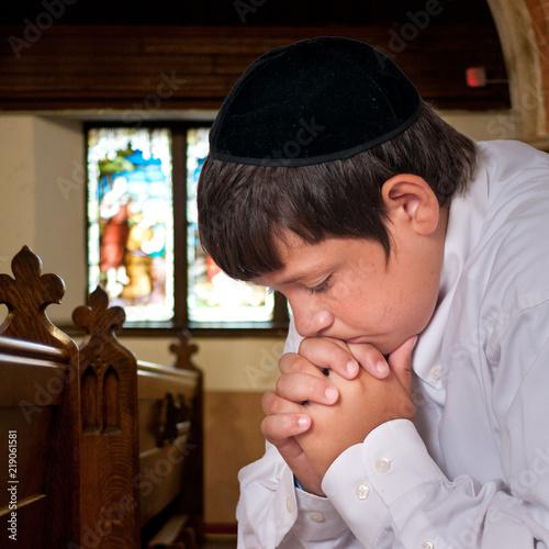 Jewish boy prays alone in prayer house. Fototapet