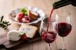Leinwanddruck Bild - 赤ワインと料理