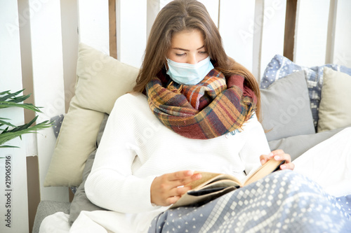 Stampa su Tela  ill young girl with fever spending time at home