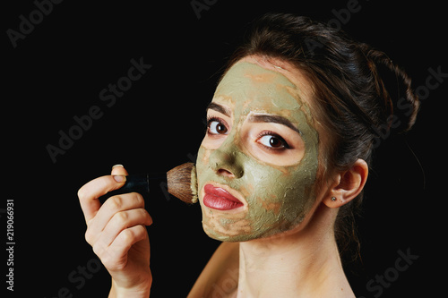Photo  portrait of a young attractive woman in a cosmetic mask