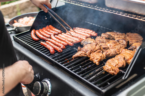 Fototapeta Barbecue grill bbq on propane gas grill steaks bratwurst sausages meat meal obraz