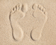 Two Footprints In Sand At The ...