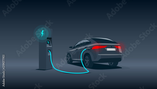 фотография Vector illustration of a luxury black electric car suv charging at the charger station during night time low demand off peak electricity