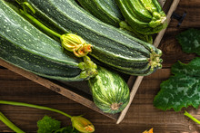 Bio Organic Zucchini In Wooden Box, Fresh Vegetables On Farmer Market, Harvest Of Courgette