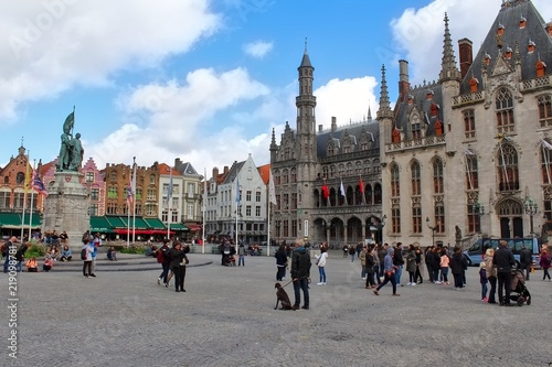 bruges market markt square with tourists in autumn