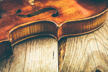 Violin On A Table Of Rough Boards