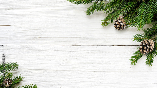 Fotografia Christmas Fir tree branches and pine cones background