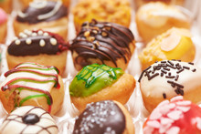 Close-up View Rows Of Doughnuts In A Box