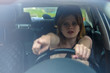 the frightened girl behind the wheel of a car