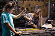 two young women working in workshop