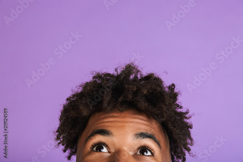 Fotografía  Half face portrait of a young afro american man isolated