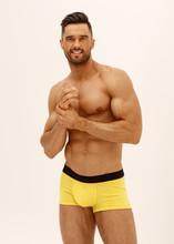 Sexy Smiling Man Wear Underwear Isloated On Studio Background