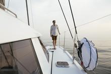 Mature Man Walking On Catamaran