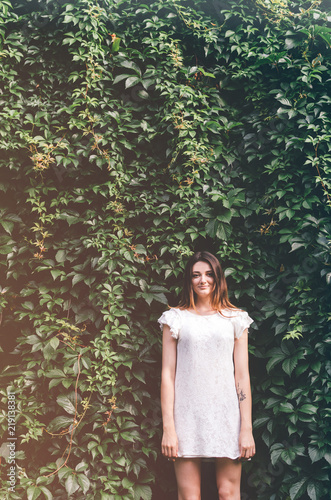Fotografie, Obraz  Beautiful young woman in wild leaves (grapes)