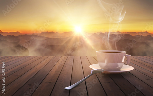 Fototapeta Close up coffee cup on wooden table at sunset obraz