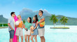 travel, tourism and summer holidays concept - group of happy smiling friends in sunglasses with beach ball, towel, camera and air mattress at touristic resort over bora bora island beach background