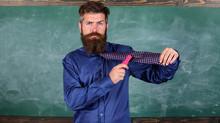 School Stationery. Man Scruffy Use Stapler Dangerous Way. Teacher Bearded Man With Pink Stapler Chalkboard Background. School Accident Prevention. Hipster Teacher Formal Wear Necktie Holds Stapler