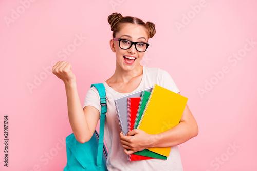 Foto  Sweet brunette girl rejoices at the new lessons. Girl joyfully h