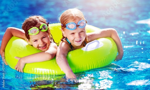 Photo  Children playing in pool. Two little girls having fun in the
