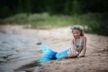 The Little Mermaid On The Beach With A Seashell