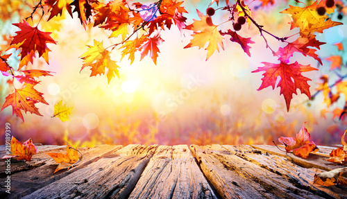 Fototapeta Wooden Table With Red Leaves And Autumn Background
