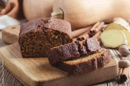 Fototapeta Pumpkin loaf cake on rustic wooden board