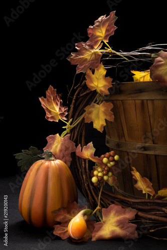 Deurstickers Herfst Autumn scene with apple basket, decor pumpkin, and leaves on black background