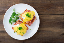 Eggs Benedict With Bacon On Wo...