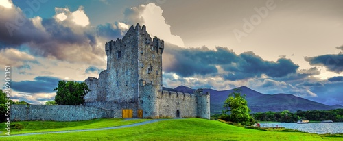 Poster Landscapes Idyllic landscape of Ross Castle in the Killarney National Park in Ireland. Travel by car through the Ring of Kerry.