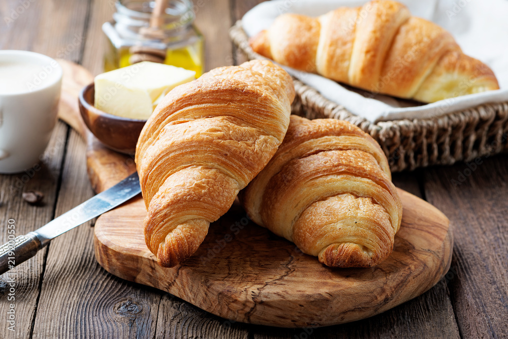Obraz Delicious breakfast with fresh croissants and coffee served with butter and honey. fototapeta, plakat
