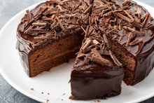 Sliced Tasty Chocolate Cake On Wooden Background.