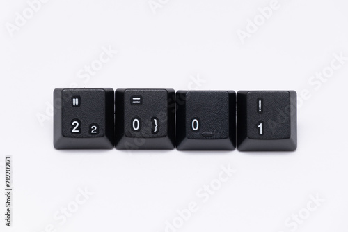 Fotografia  Black keys of keyboard with different years, words, names