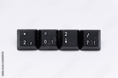 Photo  Black keys of keyboard with different years, words, names