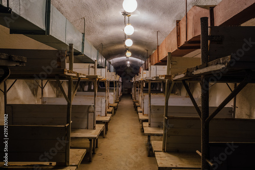 Photo  Wooden double-decker beds inside old abandoned soviet bomb shelter