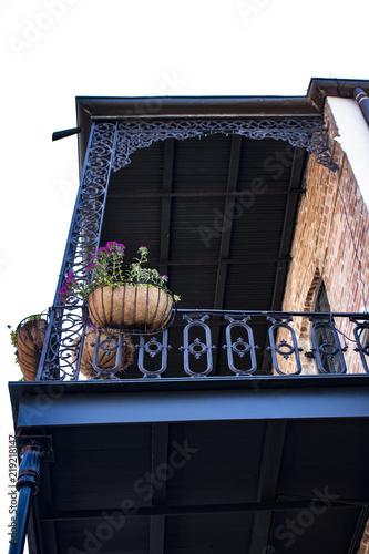 balcony flower baskets Beautiful Black Wrought Iron Balcony With Flower Baskets