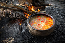 Cooking Dinner On Firewood Stove. Cooking Using Firewood Is An Survival Skill Needed When Going To The Wilderness Or Outdoor Activity.