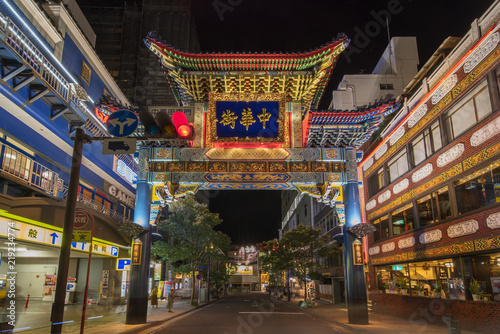 Large blue Chinese portal through which the sun rises whose protective animal is the blue dragon and which marks the eastern entrance to the Yokohama china town in Japan.