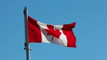 A Canadian Flag In The Wind Wi...